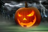 Creepy Jack o Lantern in a misty graveyard with a dramatic thunderstorm going on in the background poster