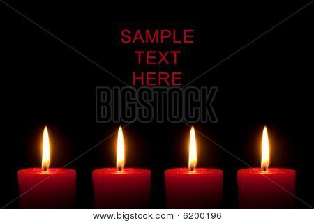 Four burning red candles in front of black background poster