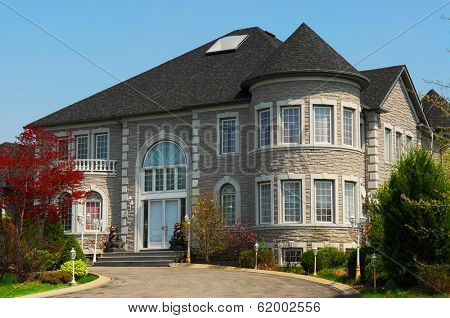 Exterior of a  large beautiful executive home under blue sky
