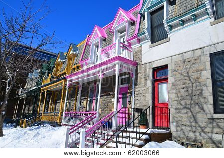 Windows and cornices full-color houses typical of Montreal.
