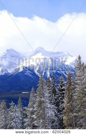 Snowy mountain ridges at Lake Louise in Canadian Rocky mountains