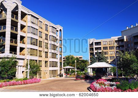 View of modern upscale condominium buildings with landscaping