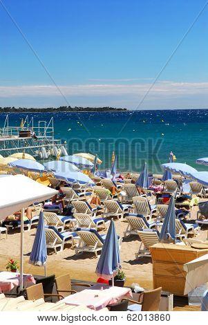 Beach along Croisette promenade in Cannes, France