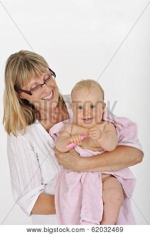 grandmother holding her grandchild