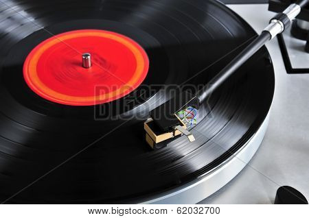 Vinyl record spinning on turntable close up