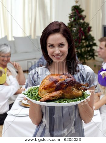 Woman Showing To The Camera Christmas Turkey