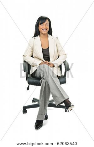 Young smiling black woman business manager sitting in leather office chair