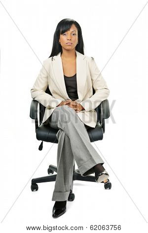 Black woman business manager sitting in leather office chair