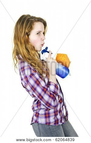 Playful young woman having fun with cleaning supplies isolated on white