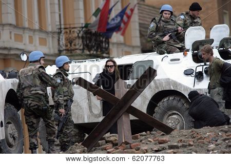 ESZTERGOM, HUNGARY - NOVEMBER 10: Angelina Jolie gives instructions to actors dressed as United Nations peace keepers on the set of In The Land Of Blood And Honey  in Esztergom, Hungary, on Wednesday, November 10, 2010.
