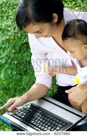 Mother and baby fun with a laptop