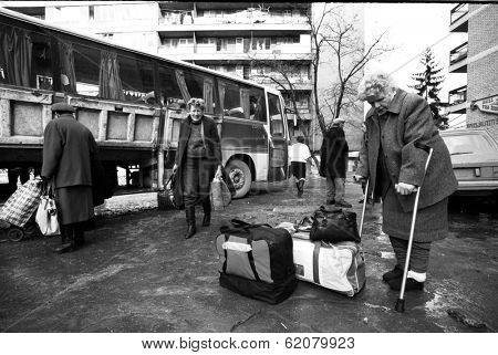 SARAJEVO, BOSNIA - MAR 15: Bosnian Serb women prepare to flee their homes as NATO troops pour into  Sarajevo, Bosnia, on Friday, March 15, 1996. The arrival of NATO peace keepers signaled the end of a bloody civil war.