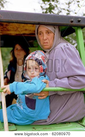 SUVA REKA, KOSOVO - OCTOBER 10: Kosovar refugees arrive by tractor to a makeshift camp near the border of Albania. Thousands of people have left their homes as a result of Serb army shelling October 10, 1998 in Suva Reka, Kosovo