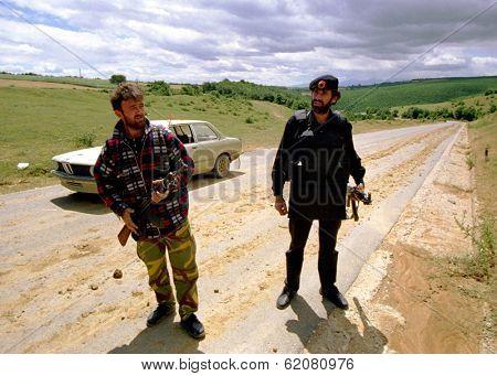 DRENICA, KOSOVO - JULY 7: Guerrillas with the Kosovo Liberation Army (KLA) at a checkpoint near the town of Sirbica on July 7, 1998 in Drenica, Kosovo
