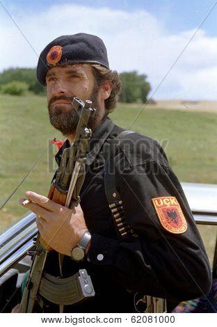 DRENICA, KOSOVO - JULY 7:  A guerrilla with the Kosovo Liberation Army (KLA) at a checkpoint near the town of Sirbica on July 7, 1998 in Drenica, Kosovo
