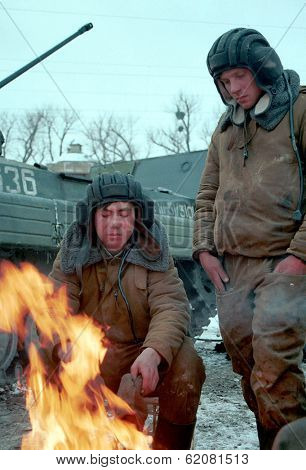 GUDERMES, CHECHNYA - JANUARY 16: Russian army armor troops try to keep warm, and catch a few minutes rest between fighting Chechen rebels on January 16, 2000 in Gudermes, Chechnya
