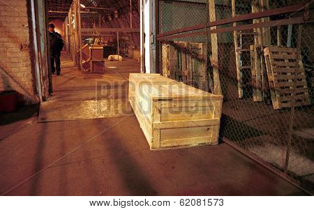 MOSCOW - JANUARY 17: A railway worker at Moscow's Yaroslavsky station retrieves a coffin containing the body of a Russian soldier killed last week in Chechnya identified only as Gavrikov, A.A on January 17, 2000 in Moscow