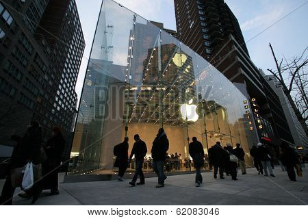 NYC - DEC 30: Pedestrians walk past an official Apple, Inc.  retail center in New York City, New York, on Wednesday,  December 30, 2009.