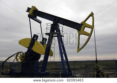 PLOIESTI , ROMANIA - NOV 8: A lone pump jack owned and operated by Romanian oil and gas company S.C. Petrom S.A. pulls crude oil out of the ground near Ploiesti, Romania, on Thursday, November 8, 2007.