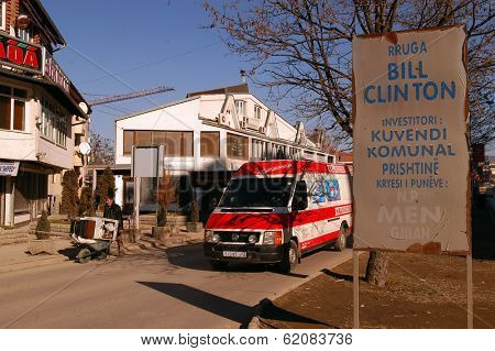 PRISTINA, KOSOVO - JAN 26: An delivery van asses a man pushing a wheelbarrow carrying a broken refrigerator and television along Bill Clinton Boulevard in Pristina, Kosovo, on Saturday, January, 26, 2008.