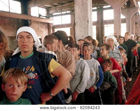 KUKES, ALBANIA, 04 MAY 1999 --- Kosovar Albanian refugees line up for care at a Medicines Sans Frontiere  (MSF) medical center at  a camp just inside the Albanian border from Kosovo.