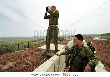HAR KACHAL, ISRAEL - MARCH 28:  Israeli defense force (IDF) soldiers look over the border into the Syrian village of Kumeitra high into the Golan Heights on March 28, 2000  in Har Kachal, Israel.