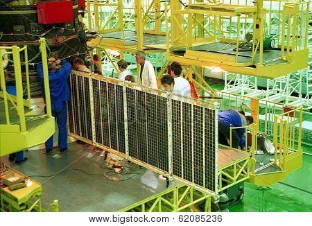 BAIKONUR COSMODROME - OCTOBER 29 2000:  Russian space technicians and engineers test the solar array on a Progress M1 spacecraft in the RSC Energia vehicle assembly building in Baikonur, Kazakhstan.