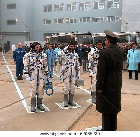 BAIKONUR COSMODROME - OCTOBER 31:  The crew of the first mission to permanently man the international space station give their final salutes prior to launch at the Cosmodrome on October 31, 2000.