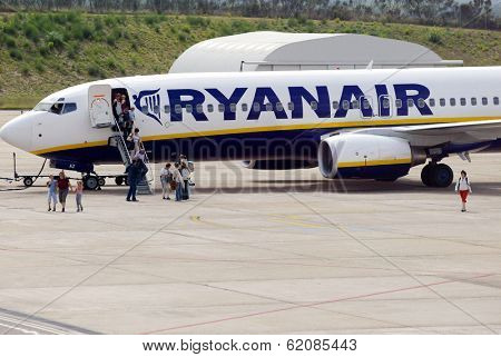 GERONA - OCTOBER 12: A Ryanair airplane arrive at the airport in Gerona, Spain on October 21, 2005.