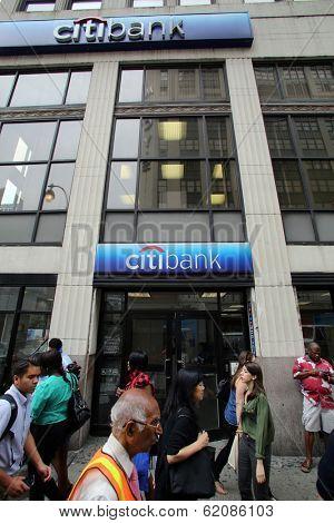 NEW YORK CITY - JULY 11: Pedestrians walk past a Citibank bank branch in midtown Manhattan on Thursday, July 11, 2013.