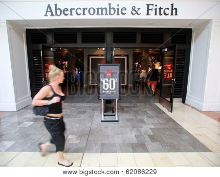 PARAMUS - JULY 9: Shoppers walk past an Abercrombie & Fitch retail clothing store in Paramus, New Jersey, on Tuesday, July 9, 2013.