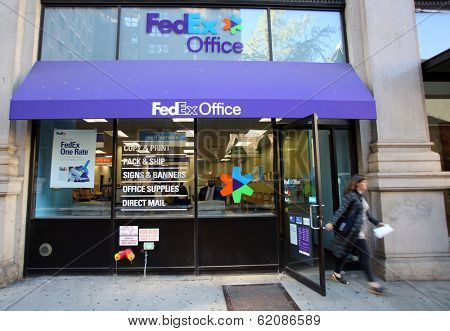 NEW YORK CITY - OCT 20 2013: Pedestrians walk past a FedEx Store retail shop in Manhattan on Sunday, October 20, 2013.