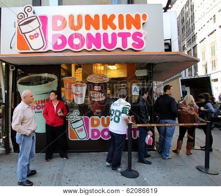 NEW YORK CITY - OCT 20 2013: People line up for coffee and donuts at a Dunkin' Donuts store in Manhattan on Sunday, October 20, 2013.