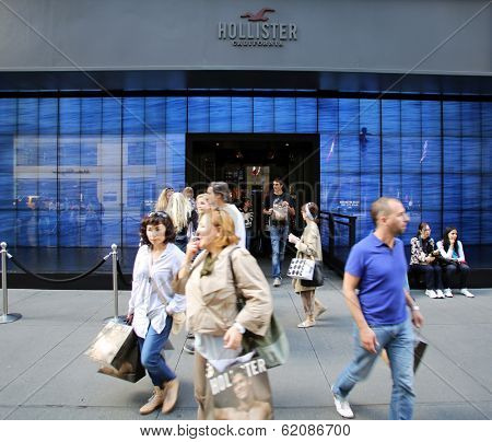 NEW YORK CITY - OCT 18:  Pedestrians walk past a a Hollister clothing store in Manattan on Friday, October 18, 2013. Hollister Co.,  is an American lifestyle brand by Abercrombie & Fitch Co