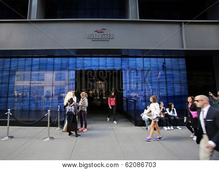 NEW YORK CITY - OCT 18:  Pedestrians walk past a a Hollister clothing store in Manattan on Friday, October 18, 2013. Hollister Co, is an American lifestyle brand by Abercrombie & Fitch Co