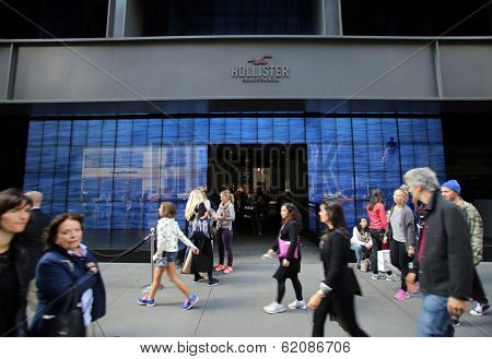 NEW YORK CITY - OCT 18:  Pedestrians walk past a a Hollister clothing store in Manattan on Friday, October 18, 2013. Hollister Co.  is an American lifestyle brand by Abercrombie & Fitch Co