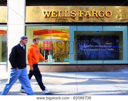 NEW YORK CITY - OCT 24 2013:  Pedestrians walk past a branch office of Wells Fargo & Company bank in Manhattan on Sunday, October 20, 2013.