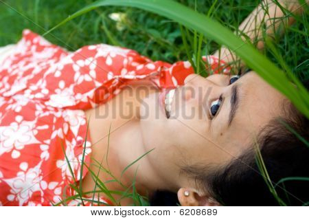Young Woman Laying On Grass