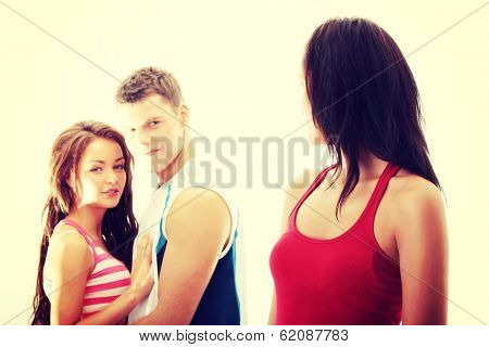 Unfaithful boyfriend concept. Boyfriend is flirting with another girl. Isolated on white background