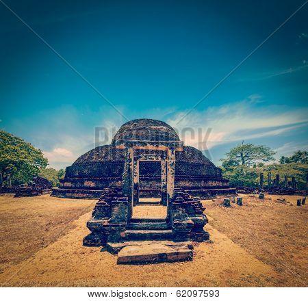 Vintage retro hipster style travel image of ancient Buddhist dagoba (stupe) Pabula Vihara. Ancient city of Pollonaruwa, Sri Lanka