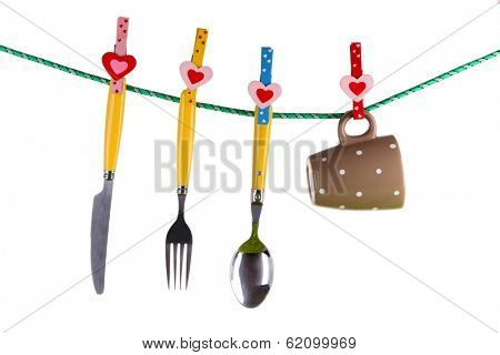 Crockery dried on rope isolated on white