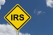 IRS Warning Sign An American road warning sign with word IRS with a sky background poster