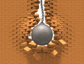 Rusty wrecking ball destroying the red brick wall poster