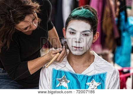 Woman Brushing Makeup On Clown