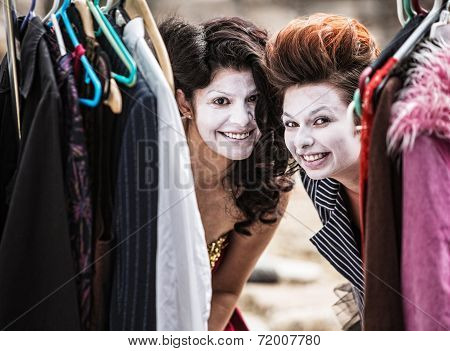 Clowns Peeking From Clothes Rack