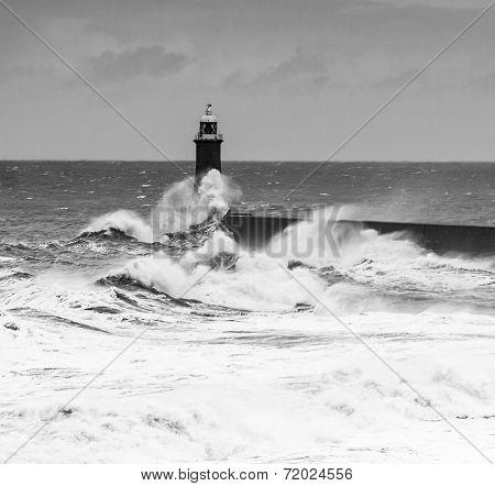 Powerful Waves Crash Over Lighthouse