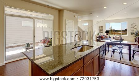 House Interior With Open Floor Plan. Kitchen Island With Granite Top