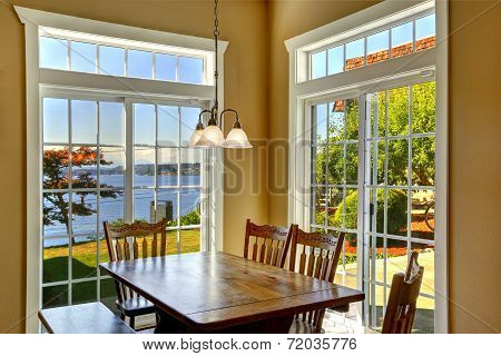 Bright Dining Area With Rustic Table And French Windows