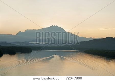 Fisheman Headding Home At Early Morning With Mountain As Background