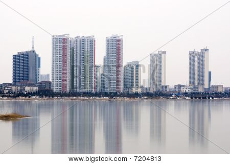 New under construction city of Modern China reflected in the water